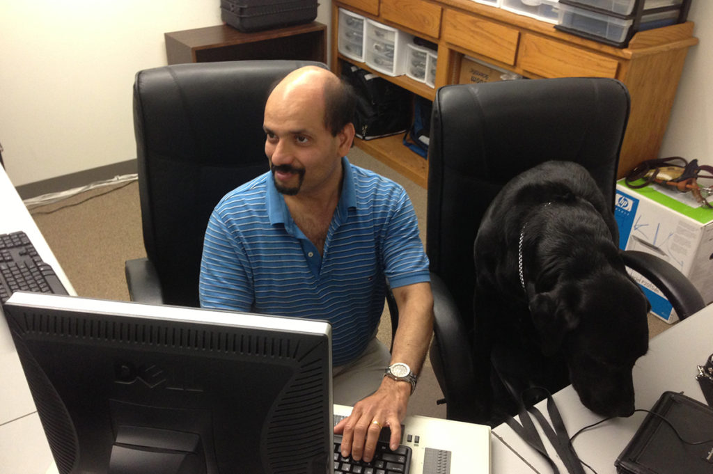 Bapin concentrates on work as Walter grabs a sit  next to him